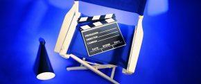 Аксессуары режиссёра: стул, хлопушка, рупор (мегафон)